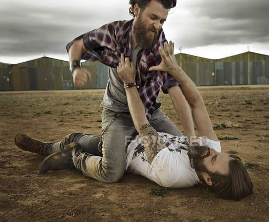 focused_181048050-stock-photo-two-men-full-beards-fighting